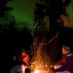 Northern Lights and Campfire: Northern Lights over the Pigeon River near Grand Portage, Minnesota.