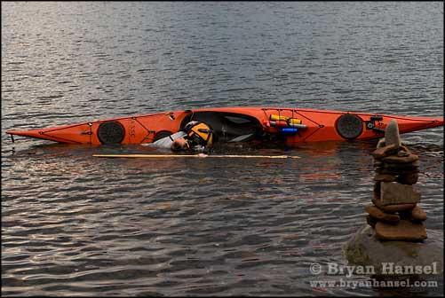 Kayaker and Inuksuk