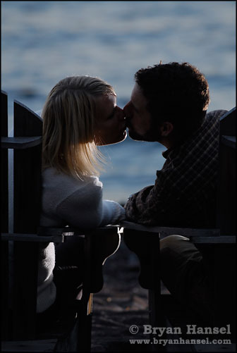 Couple kissing in chairs at Lutsen Resort in Mn