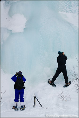 Photographers in front of frozen waterfall