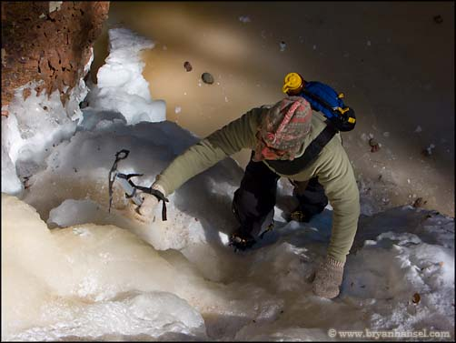 Ilena ice climbing up a small fall on the Kudunce River in Minnesota