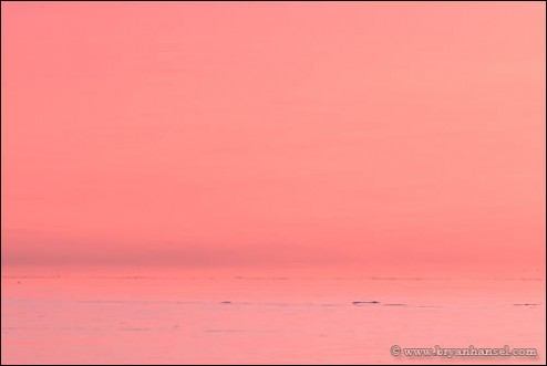 Pink winter sunset over Lake Superior.