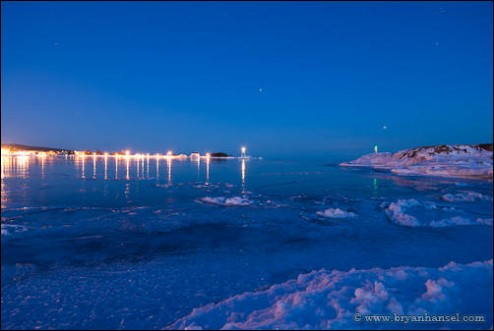 Grand Marais harbor at twilight with star trails.
