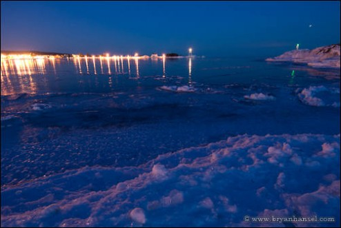 Grand Marais harbor at night with star trails.
