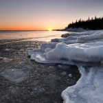 Winter sunset over an icy Lake Superior.