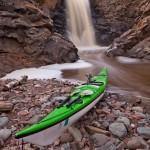 Fall River behind a kayak.