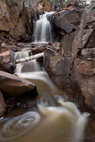 Waterfall cascades down rocks.