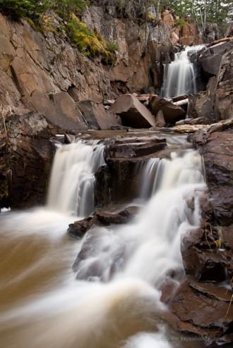 A small waterfall on an unnamed creek near Cutface Creek. Minnesota.