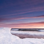 In the depths of winter, waves wash up against ice formations along Lake Superior's shoreline.