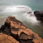 Lake Superior waves wash over rocks.