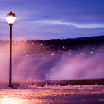 Spray rushing past a Grand Marais street light.