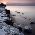 Sunrise over Lake Superior. Long exposure to blur waves.
