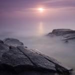 The sunrise, fog, rocks.