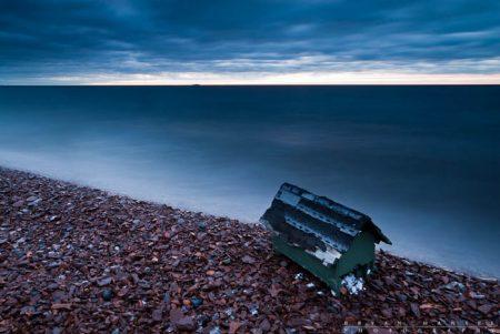Tiny Cabin: A found pump cover on Five Mile Beach near Grand Marais. Lake Superior. Minnesota.