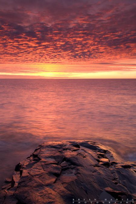 Fire Sunrise: The sky turns to fire at sunrise over Lake Superior. 120110-13