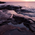 The sky turns to fire at sunrise over Lake Superior. Looking towards Artist's Point near Grand Marais.