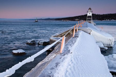 The breakwater leading to the Grand Marais lilghthouse is coated with ice and frost. 120113-22.