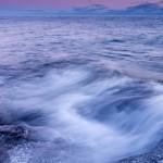 Waves wash up on the basalt shore of Butterwort Cliffs SNA near Grand Marais, MN.