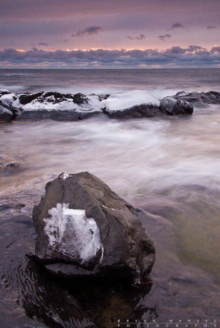 Lone Boulder on Basalt: A lone boulder sits on the basalt shoreline of Lake Superior.