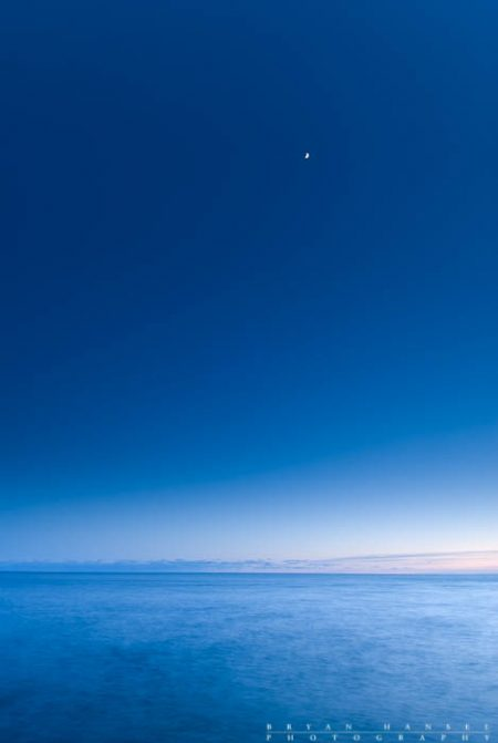 A tiny moon in a sea of blue.