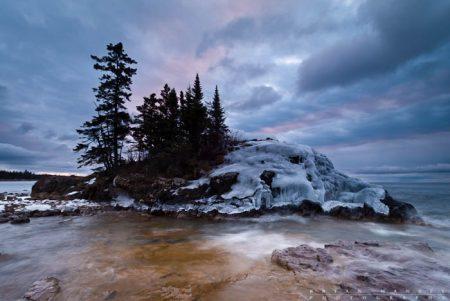 ice coated island on lake superior