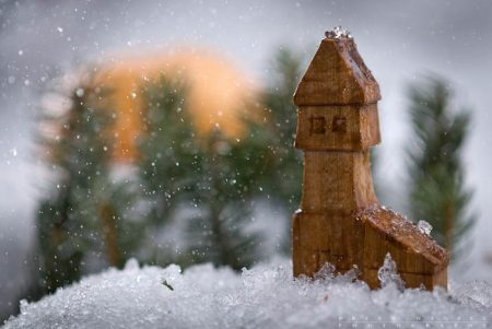 A miniature northwoods cabin at sunrise.