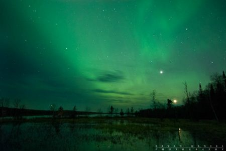 The moon and Venus over Devil Track Lake. The northern lights turn everything green.