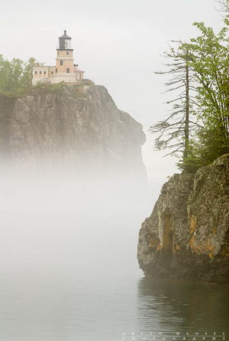 The Split Rock lighthouse watches over Lake Superior in the fog.