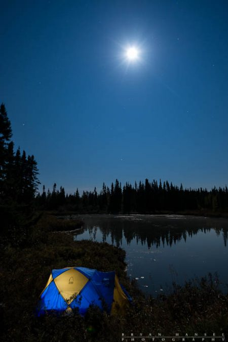 A tent under the full moon on the Cascade River.