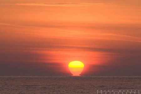 sun mirage on lake superior