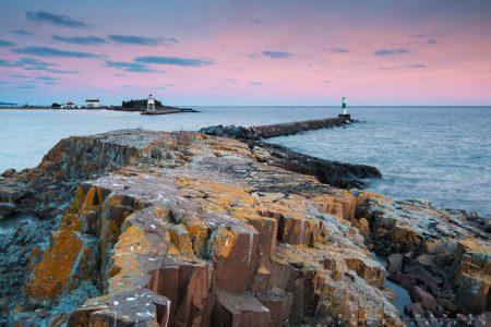 pink sky behind the grand marais lighthouse