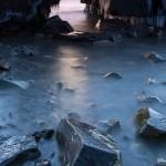 The Hollow Rock sea arch lets the dawn light shine through.