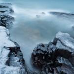 A storm sends waves over the basalt of Artist's Point. Grand Marais, Minnesota.