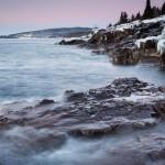 The moon hovers over Lake Superior's basalt shoreline near Terrace Point.
