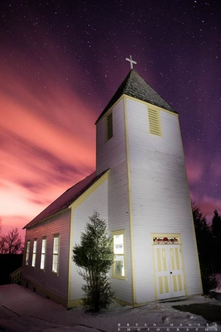 The Maple Hill Church under stars and fast moving clouds.