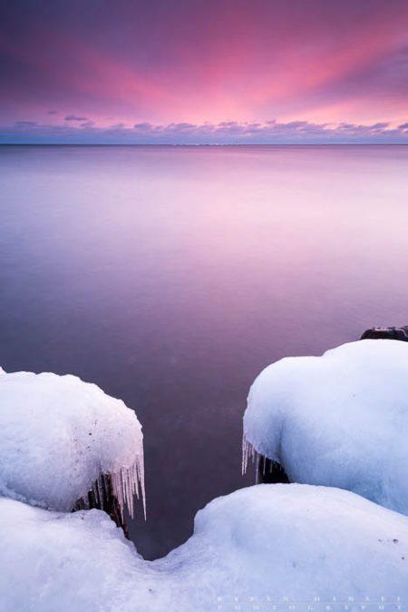 icy Lake Superior shoreline at sunset