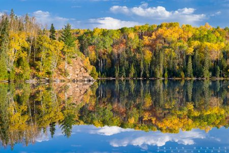 Fall color reflection on Mink Lake near the Gunflint Trail, Minnesota.