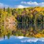 Fall color reflection on Mink Lake near the Gunflint Trail, Minnesota.