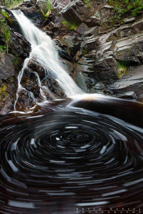 An eddy creates a circular swirl of foam on the Fall River.