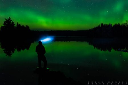 Self Portrait of me standing on a lake under the northern lights.