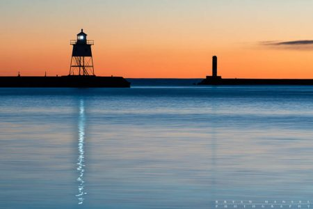 reflections of the grand marais lighthouse