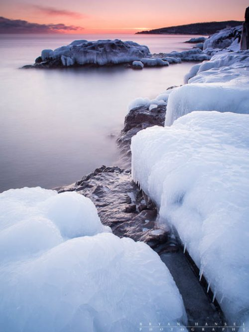 Frozen shoreline on Lake Superior at the end of January. Sunset at Cascade River State Park, Cook County, Minnesota.