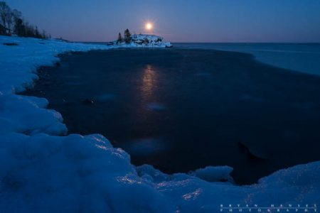 snow moon over hollow rock