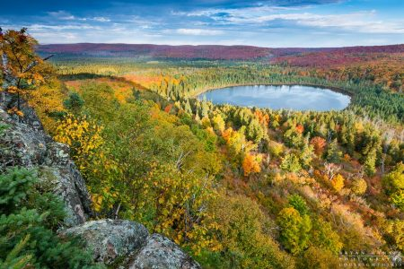 The morning sun cast low light across Oberg Lake during the fall color. Lutsen, Minnesota