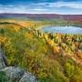 The morning sun cast low light across Oberg Lake during the fall color. Lutsen, Minnesota