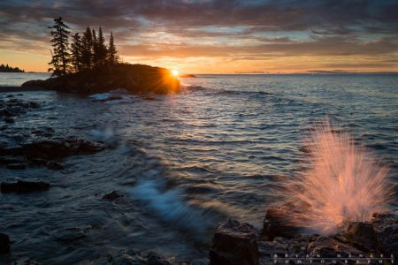 A splash at the tombolo on Lake Superior at sunrise. Cook County, Minnesota.