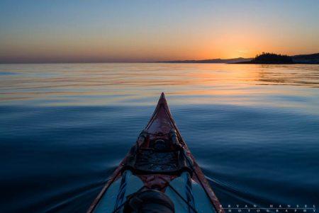 paddling lake superior at sunset