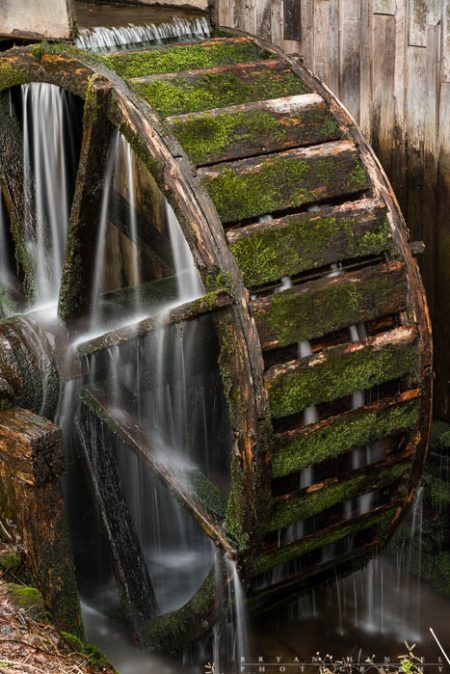water flows over a mill wheel