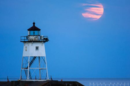 Grand Marais lighthouse and moon, Cook County