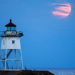 grand marais lighthouse and the moon